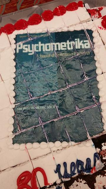 White cake with a Psychometrica cover decorated on the top